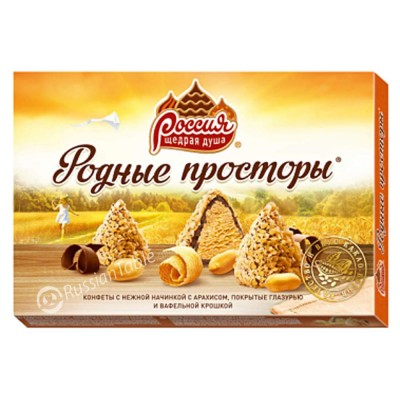 """Sweets """"Rodnyye prostory"""" with a delicate filling, peanuts, covered with icing and waffle chips"""